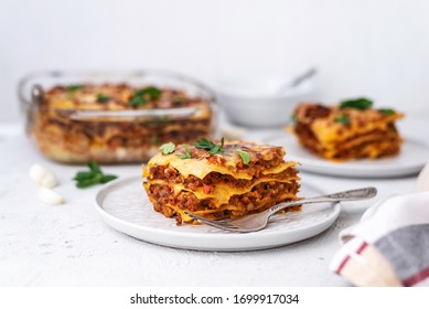 Delicious homemade italian Lasagna with bachamel sauce on gray background. Hot tasty Lasagna with cheese