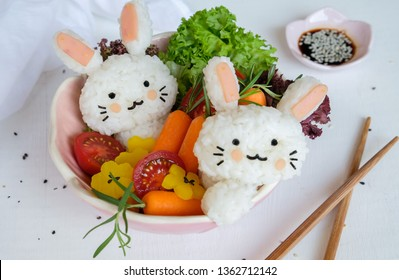 Delicious homemade Japanese cuisine / Rabbit Shaped Onigiri with Garden Salad / Healthy meal, decorated with family members for lunch or dinner