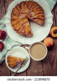 Delicious homemade nectarine cake on wooden background. Toned picture