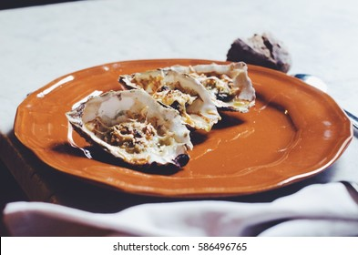 Delicious home-made oysters served in a plate.