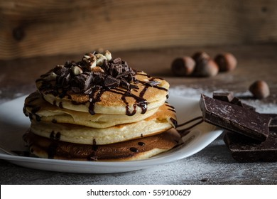 Delicious homemade pancakes with chocolate topping,chopped chocolate  and hazelnut