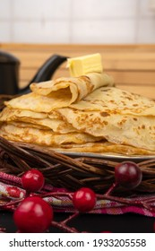 Delicious homemade pancakes with a piece of butter on Shrovetide. Delicious and delicious breakfast at home or in a cafe