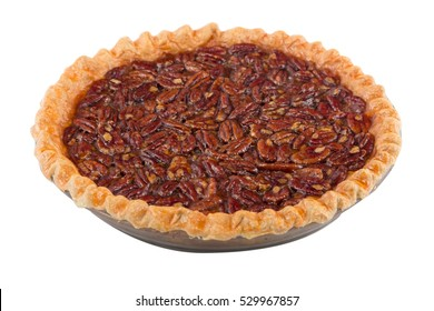 Delicious homemade pecan pie in a glass serving dish.