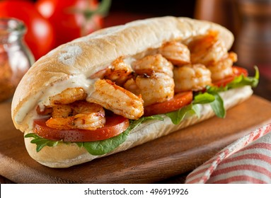 A delicious homemade spicy shrimp sandwich with lettuce, tomato, and tartar sauce.