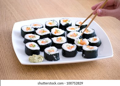 delicious homemade sushi in a white plate