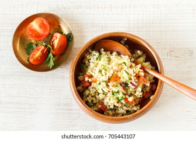 Delicious homemade vegetarian bulgur dish with vegetables and fresh herbs