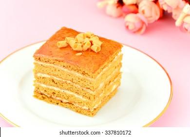 Delicious Honey Cake Decorated with Chocolate. Studio Photo