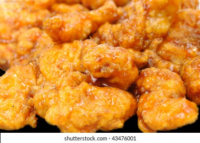 Delicious honey glazed orange chicken pieces macro