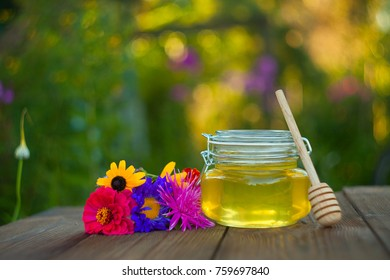 Delicious delicious honey in a jar on the table