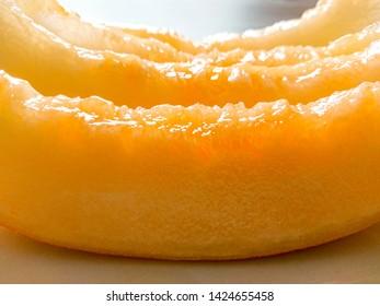 Delicious honey melon pieces as background, soft focus