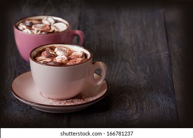 Delicious hot chocolate with marshmallow on wooden background.