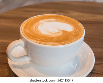 Delicious hot coffee in white cup on wooden table, Hot chocolate