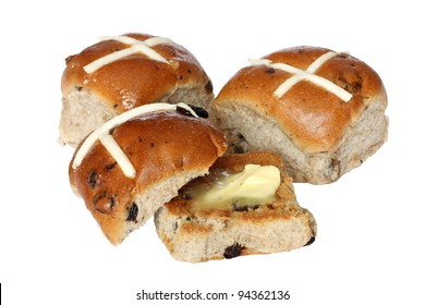 Delicious hot cross buns, one toasted with butter, isolated on white.