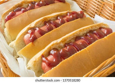 Delicious hot dog with sausage, bread and ketchup