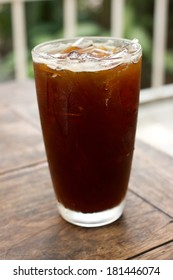 Delicious ice coffee americano on wood table.