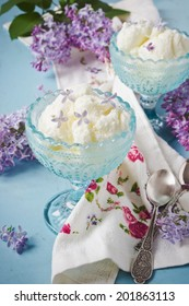 delicious ice cream  in blue cups  and lilac flowers. selective focus