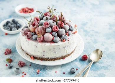 delicious ice cream cake with frozen berries , selective focus