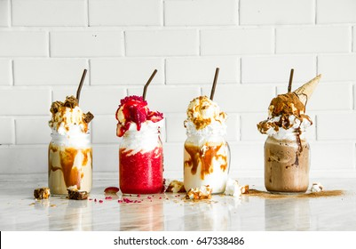 Delicious ice cream float, vanilla, strawberry, coffee, chocolate and white wall background