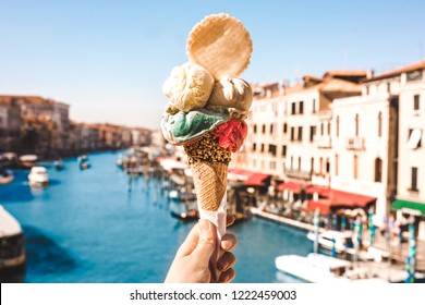 Delicious icecream in beautiful Venezia, Italy in front of a canal and historic buildings