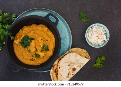 Delicious Indian chicken korma with rice and butter naan, top view