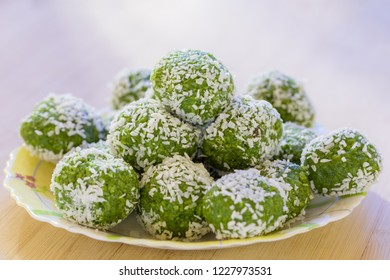 Delicious Indian Dessert (Laddoos) Made Of Betel Leaves (Paan) and Coconut Stacked On Top of Each Other