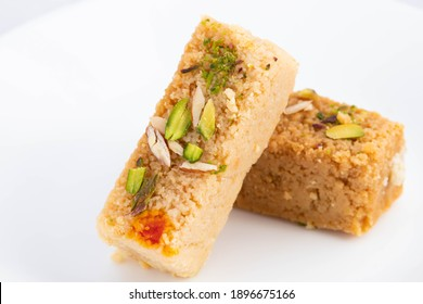 Delicious Indian Mithai Hot Milkcake Kalakand Burfi Or Alwar Ka Mawa Barfi Made Of Khoya Doodh Malai Decorated With Badam Or Badaam Nuts Kaju And Pista. Isolated On White Background With Copy Space