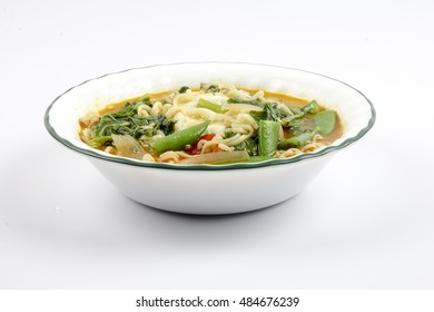 Delicious instant noodles with vegetables and egg. Copy space