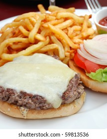 delicious isolated american cheese burger with fries on background