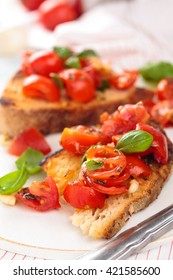 Delicious Italian bruschetta with cherry tomatoes, basil and garlic.