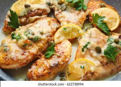 Delicious Italian chicken piccata with lemon, closeup