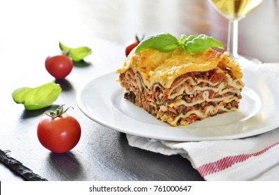 Delicious italian Lasagne with spinach on a white plate. Italian food.