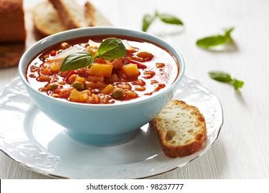 Delicious Italian minestrone soup with bread