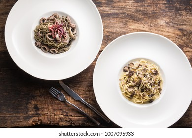 Delicious Italian pasta with squid rings and truffles.  Spagetti with truffle mushrooms on the wooden vintage background. Top view.
