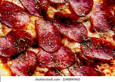 Delicious italian pepperoni pizza texture close up