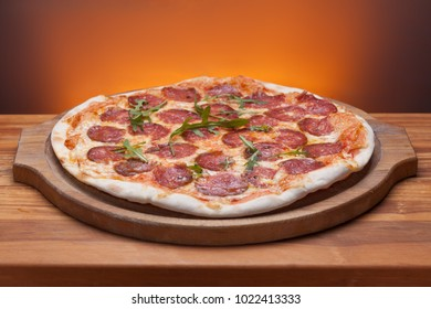 Delicious italian pizza served on wooden table.
