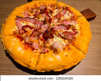 Delicious Italian pizza sliced ham, bacon and cheese with cheese crust pizza. Close up of cheesy crust pizza homemade.