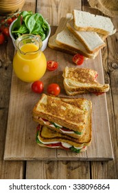 Delicious Italian sandwich, chorizo, mozzarella, salad with fresh orange juice