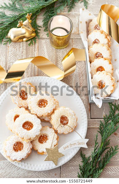 Delicious jam filled Christmas cookies powdered with sugar