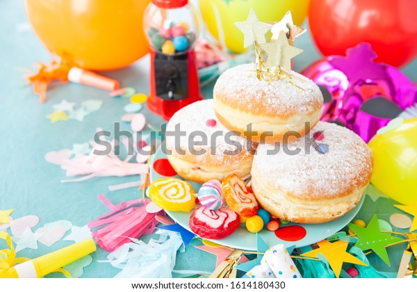 Delicious jam-filled donuts and colorful candies and sweets
