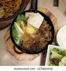 Delicious japanese food set with yakisuki, yakisoba, salad and rice