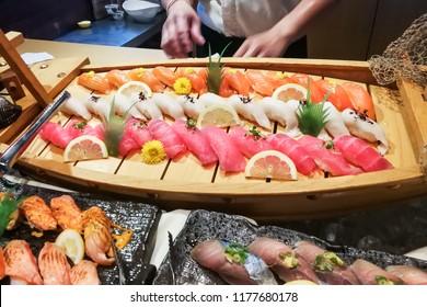 Delicious Japanese fresh shashimi sushi buffet spread at Japanese restaurant