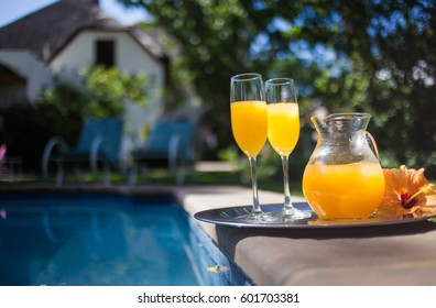 Delicious juice served on a silver platter at a pool side, ready to be drank on a warm summer day