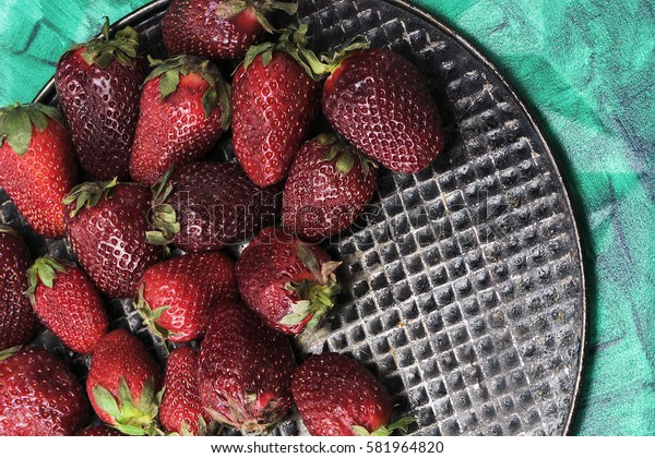Delicious, juicy strawberries closeup. The view from the top. Proper healthy eating