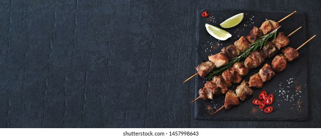 Delicious kebabs with spices. Kebab on wooden sticks.