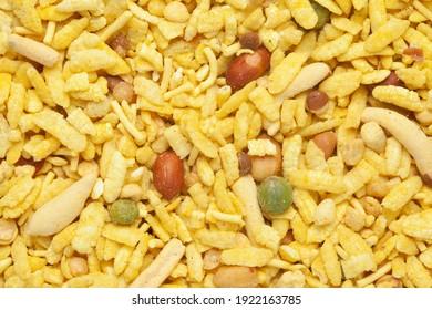 Delicious Khatta Meetha namkeen full-frame wallpaper, made with peanuts, sugar, raisins, and besan sev. Indian spicy snacks (Namkeen),  Top view angle,