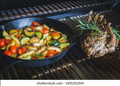 delicious lamb chops with bone grilled under flames with roasted vegetables