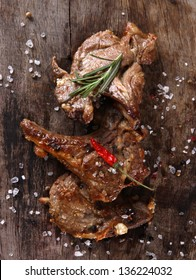 Delicious lamb chops on wooden table