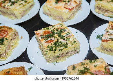 Delicious lasagna on plates. Portioned lasagna with herbs on the table