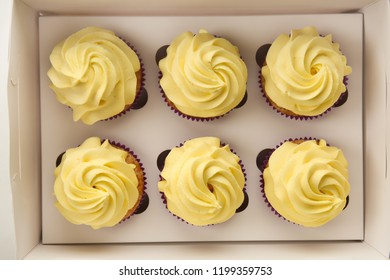 Delicious lemon cupcakes in box, top view