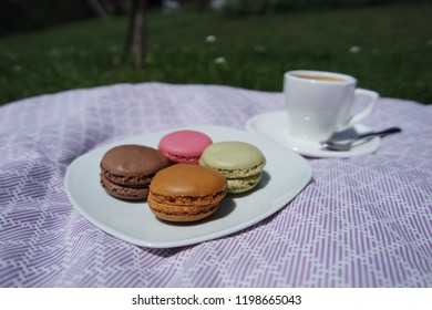 Delicious little macrons and cup of coffee